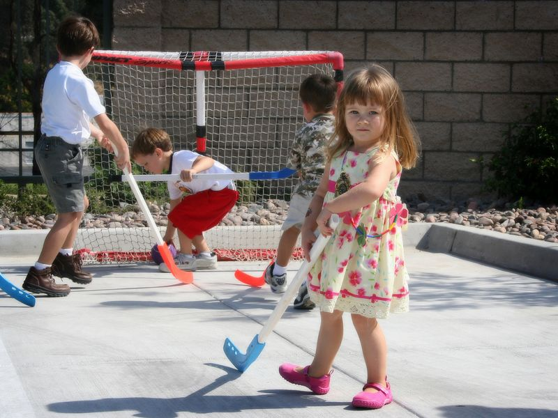 10/15 - Lili wasn't afraid to play hockey with older boys, she got right in the middle of the action.