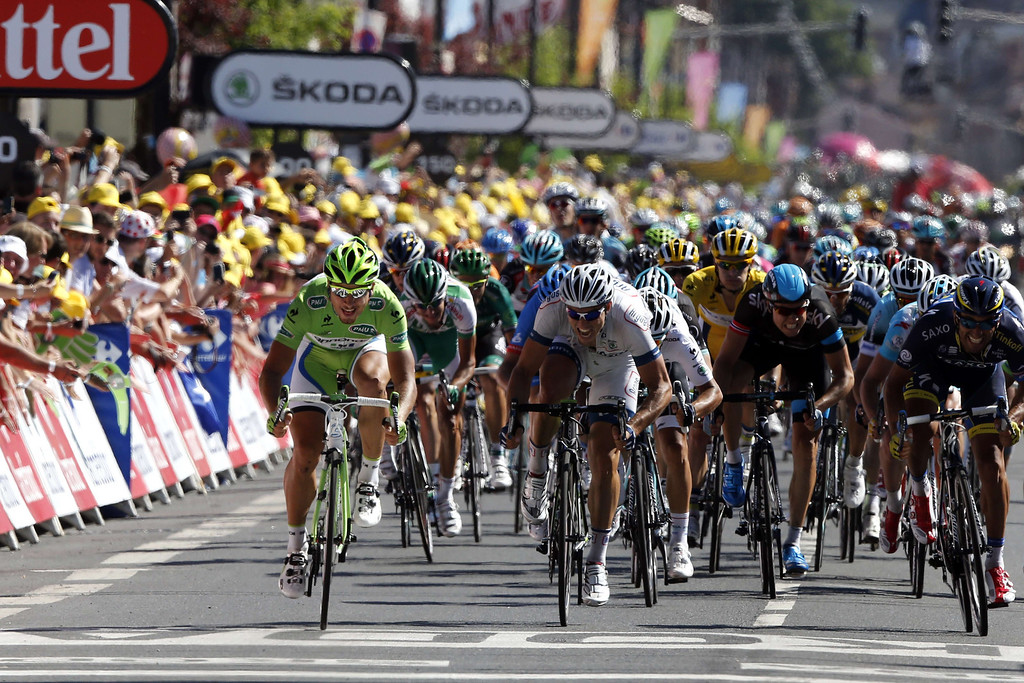 . Best sprinter\'s green jersey, Slovakia\'s Peter Sagan, (L) sprints to win at the end of the 205.5 km seventh stage of the 100th edition of the Tour de France cycling race on July 5, 2013 between Montpellier and Albi, southwestern France. PASCAL GUYOT/AFP/Getty Images