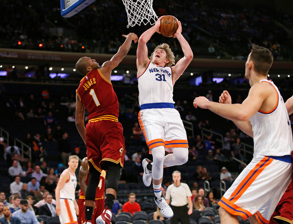 . Cleveland Cavaliers guard James Jones (1) defends as New York Knicks guard Ron Baker (31) goes up for a shot in the second half of an NBA basketball game at Madison Square Garden in New York, Wednesday, Dec. 7, 2016. The Cavaliers won, 126-94. (AP Photo/Kathy Willens)