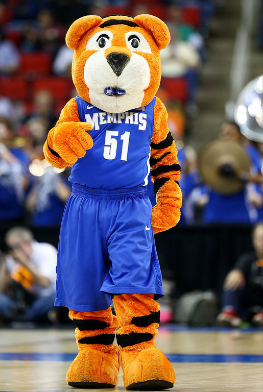 . Memphis Tigers mascot, Pouncer, performs in the first half against the George Washington Colonials during the Second Round of the 2014 NCAA Basketball Tournament at PNC Arena on March 21, 2014 in Raleigh, North Carolina.  (Photo by Streeter Lecka/Getty Images)