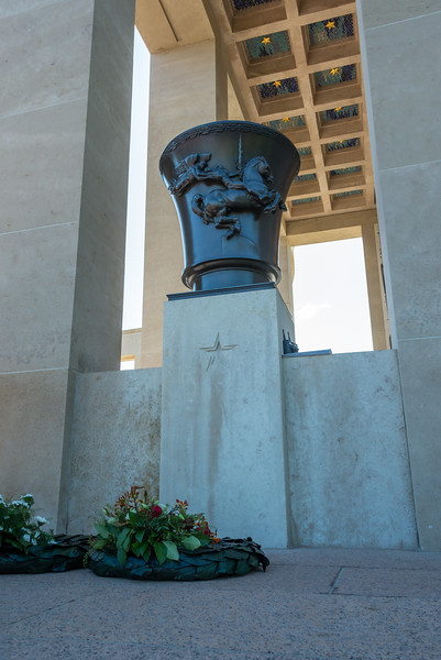 One of four large bronze urns at the memorial