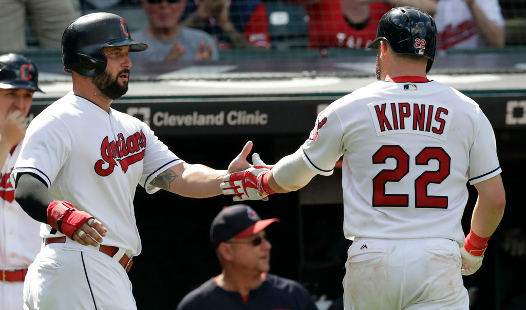 . Cleveland Indians\' Yonder Alonso, left, congratulates Jason Kipnis after Kipnis hit a one-run sacrifice fly in the eighth inning of a baseball game against the Kansas City Royals, Wednesday, Sept. 5, 2018, in Cleveland. The Indians won 3-1. (AP Photo/Tony Dejak)