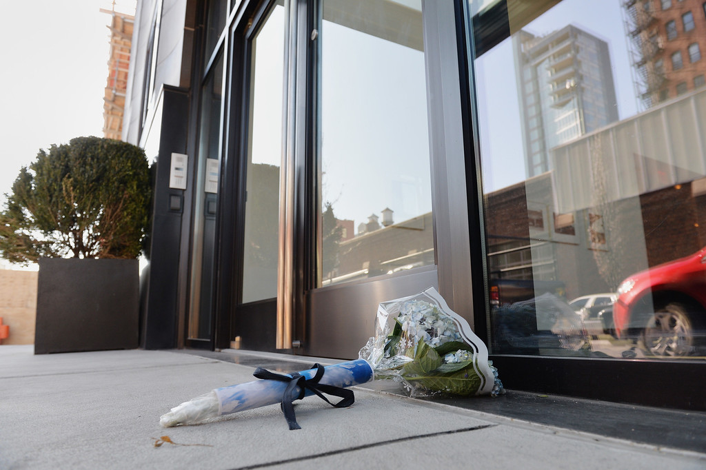 . Flowers placed outside the apartment building of fashion designer L\'Wren Scott, girlfriend of Rolling Stones frontman Mick Jagger, in New York on March 18, 2014. L\'Wren was found dead at her apartment on March 17.          (STAN HONDA/AFP/Getty Images)