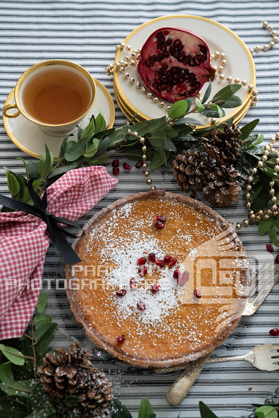 Pomegranate and powdered sugar sweet potato pie