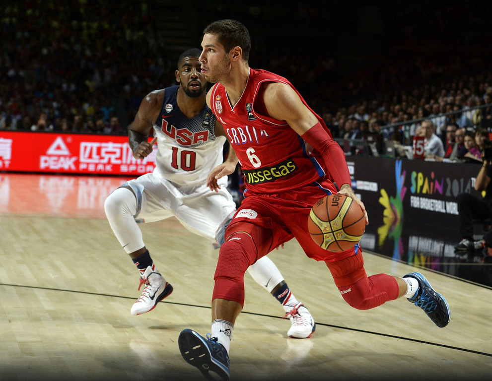 . Serbia\'s guard Stefan Jovic (R) vies with US guard Kyrie Irving (L) during the 2014 FIBA World basketball championships final match USA vs Serbia at the Palacio de los Deportes in Madrid on September 14, 2014.   GERARD JULIEN/AFP/Getty Images