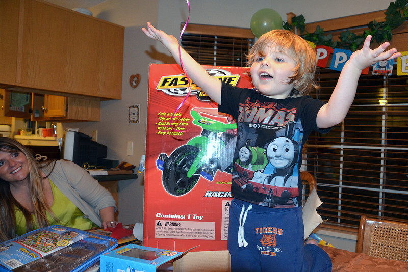 """2012-11-24 ––– Olin has to go back to Denver on Sunday, which is his birthday so we celebrated early. He was so excited as he unwrapped all his gifts. After he unwrapped the last gift, the Big Wheel type bike behind him, he turned to us and said, """"Best party ever!"""""""