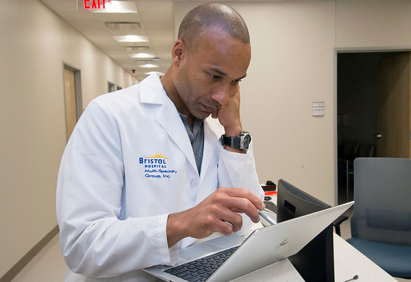 06/10/19 Wesley Bunnell | Staff Dr. R. Damani Howell, MD looks over a patients records at the Bristol Health Medical Care Center which opened for patients on Monday