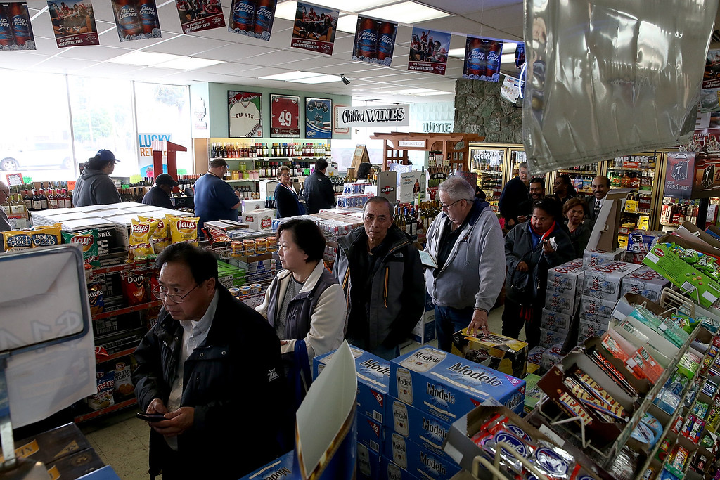 . People line up to buy Powerball tickets at Kavanagh Liquors on January 12, 2015 in San Lorenzo, California. Dozens of people lined up outside of Kavanagh Liquors, a store that has had several multi-million dollar winners, to -purchase Powerball tickets in hopes of winning the estimated record-breaking $1.5 billion dollar jackpot.  (Photo by Justin Sullivan/Getty Images)