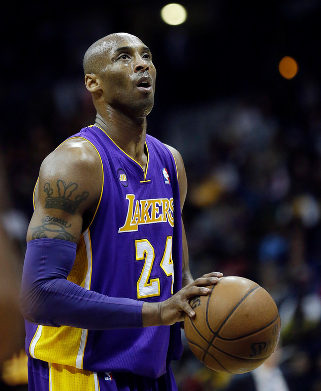 . Los Angeles Lakers shooting guard Kobe Bryant (24) is shown against Atlanta Hawks in the second half of an NBA basketball game in Atlanta Wednesday, March 13, 2013. (AP Photo/John Bazemore)
