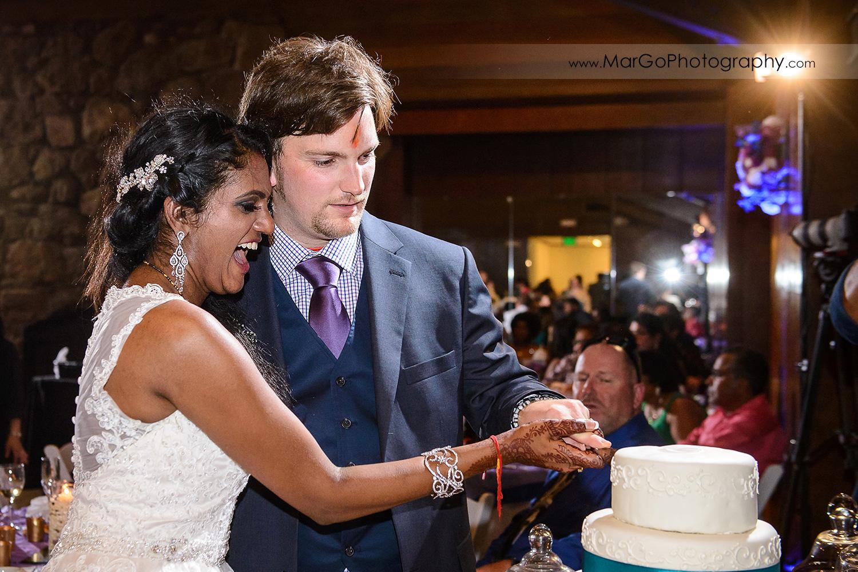 bride and groom cutting wedding cake at Brazilian Room - Tilden Regional Park, Berkeley