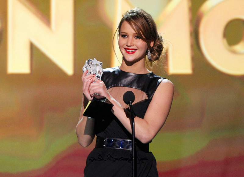 """. Jennifer Lawrence accepts the award for \""""Best Actress in an Action Movie\"""" for her role in \""""The Hunger Games\"""" at the 2013 Critics\' Choice Awards in Santa Monica, California, January 10, 2013.  REUTERS/Mario Anzuoni"""