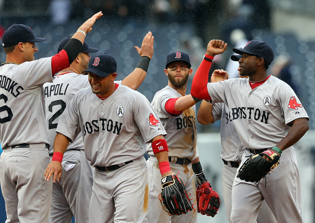. Shane Victorino #18 and Jackie Bradley #44 of the Boston Red Sox celebrate the win over the New York Yankees during Opening Day on April 1, 2013 at Yankee Stadium in the Bronx borough of New York City.The Boston Red Sox defeated the New York Yankees 8-2.  (Photo by Elsa/Getty Images)