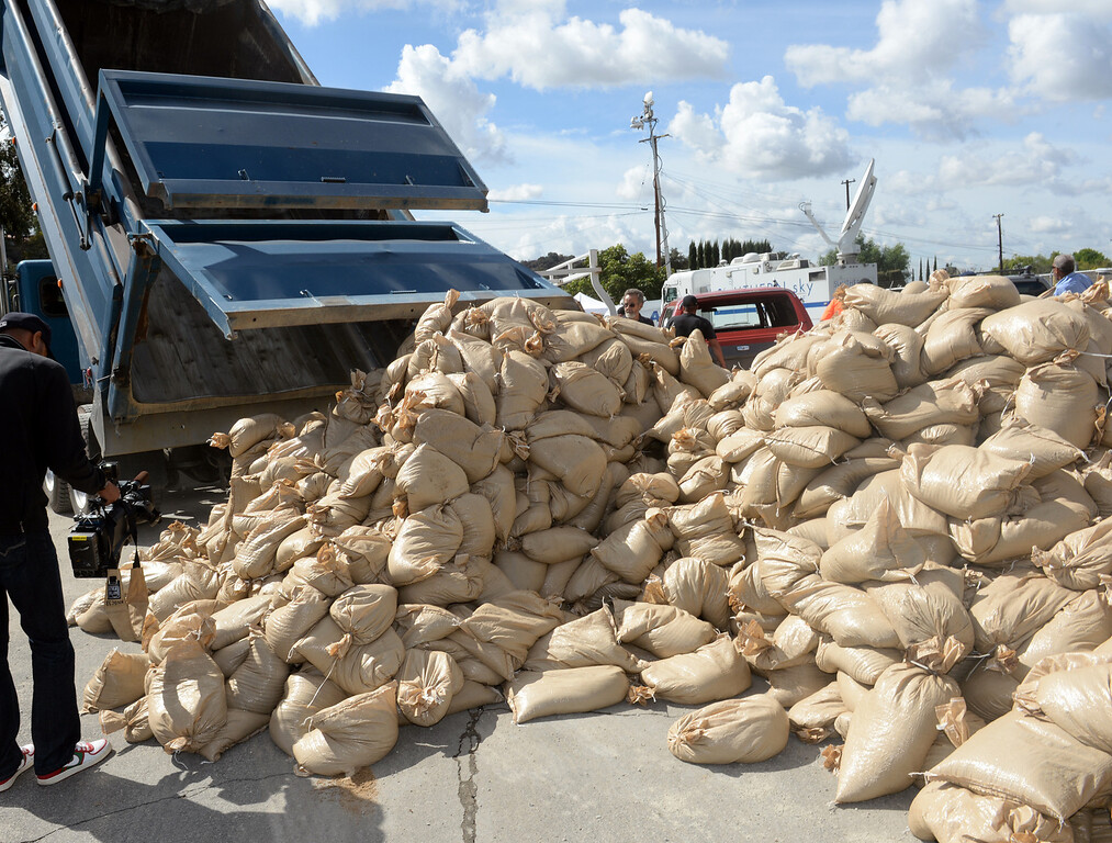 . Trucks deliver sandbags for the K-rails at the Glendora City Yard in Glendora on Thursday February 27, 2014. (Staff Photo by Keith Durflinger/San Gabriel Valley Tribune)