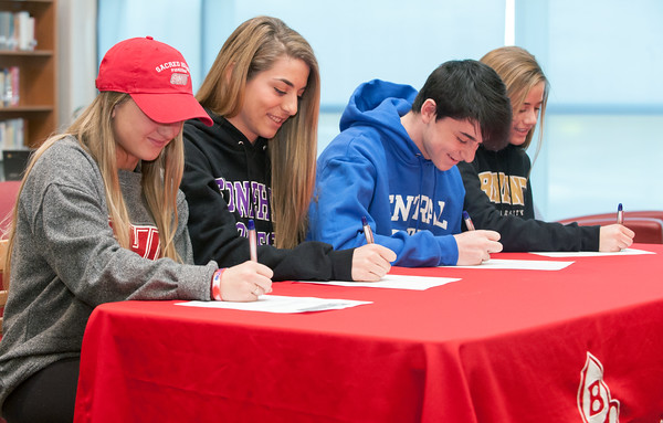 04/05/18 Wesley Bunnell   Staff Berlin High School students signing their letters of intent to play college sports on Thursday morning at Berlin High School. Lexi Kavarsky, L, committed to Sacred Heart, Julia Sisti committed to Stonehill, Noah Silverman to CCSU and Nikki Xiarhos to Bryant.