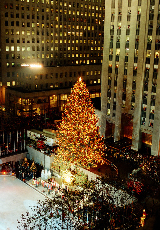 . The Christmas Tree at Rockefeller Center in New York glows shortly after its 20,000 lights on over five miles of wire, were lit, Dec. 4, 1989. The 70-foot tall Norway spruce, which towers over the center\'s skating rink, was taken from the village of Montebello in Rockland County, N.Y. (AP Photo/Ed Bailey)