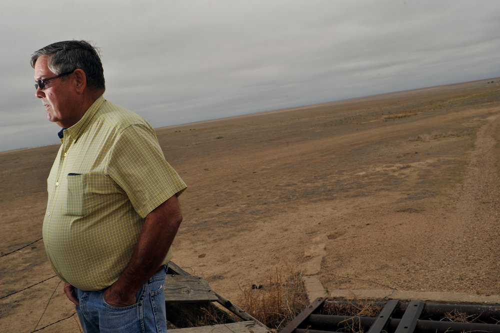 . Don Turner of Crop Risk Advisors LLC stands by an empty cattle ranch in Lamar, Colorado on June 5, 2013. Turner said farmers have moved cattle and livestocks to the other states because of drought. (Photo By Hyoung Chang/The Denver Post)