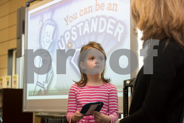11/13/17 Wesley Bunnell | Staff West Bristol School held its Just Wanna See You Be Brave day featuring anti-bullying programs for all grade levels. A kindergarten student looks at Library Media Clerk Judy Michaud as she holds the self esteem mirror before saying positive things about herself.