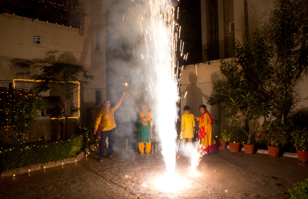 . Indians play with firecrackers during Diwali festival in New Delhi, India, Thursday, Oct. 19, 2017. Worried especially by the impact on the health of children, the Supreme Court this year banned the sale of firecrackers, that is usually in huge demand across the country as the evening sky is lit up by the festivities, in the Indian capital and neighboring areas to prevent a toxic haze after the Diwali nights that has residents hiding indoors. (AP Photo/Manish Swarup)