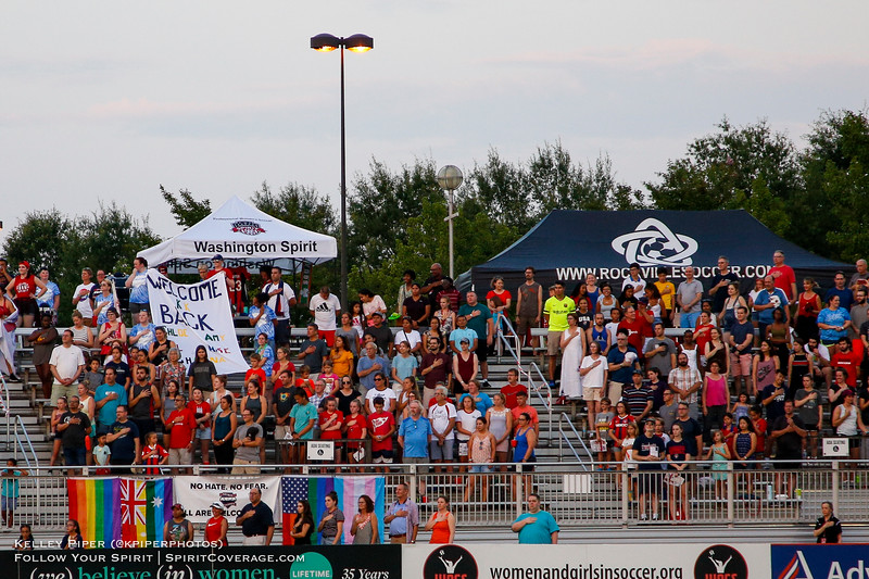 Spectators stand for the National Anthem at Maureen Hendricks Field in Boyds, MD, on July 20, 2019.