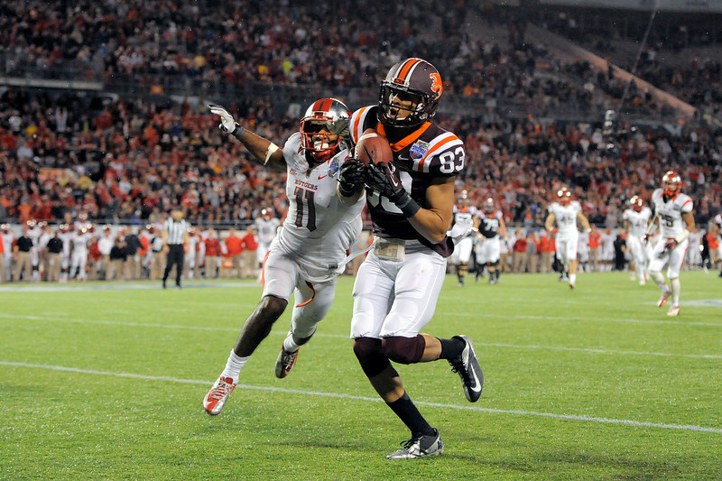 . Virginia Tech wide receiver Corey Fuller, right, hauls in a pass in the end zone for a touchdown in front of Rutgers defensive back Logan Ryan, left, during the fourth quarter of an NCAA college football Russell Athletic Bowl game on Friday, Dec. 28, 2012, in Orlando, Fla. Virginia Tech won 13-10. (AP Photo/Brian Blanco)