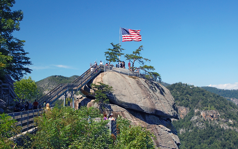 large flag flying ove rocky cliff