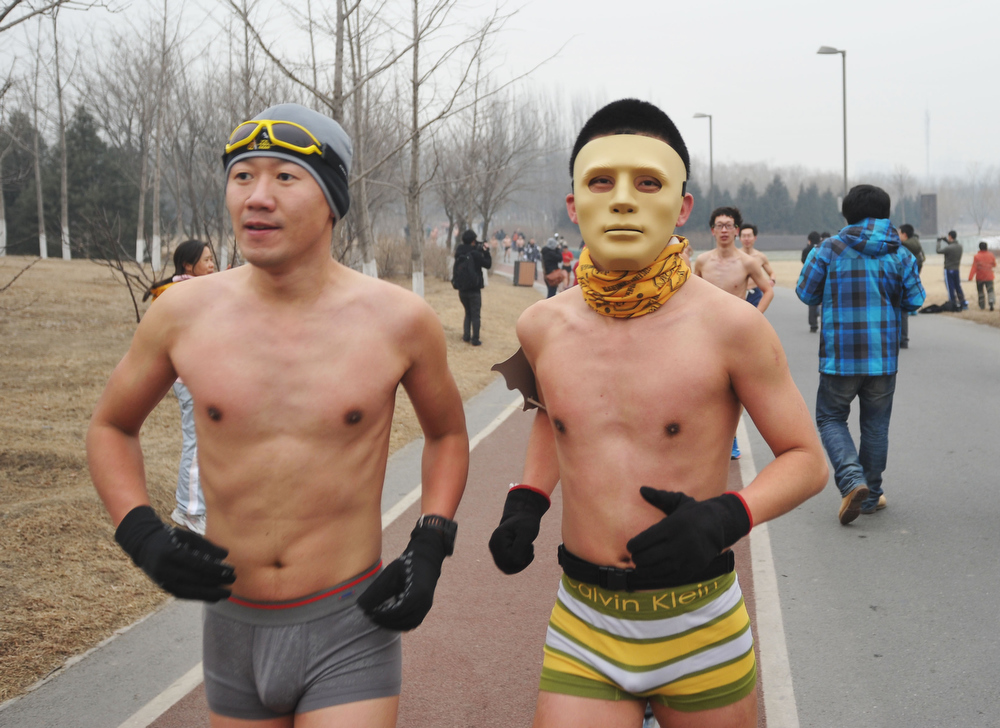. People take part in the Naked Running competition at Olympic Park on February 24, 2013 in Beijing, China. 300 participants took part in the annual 3.5 km Undie Run, which was held in Beijing\'s Olympic Forest Park on Sunday.  (Photo by ChinaFotoPress/ChinaFotoPress via Getty Images)