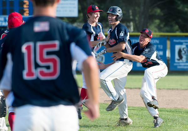 07/25/19 Wesley Bunnell | Staff Southington Legion baseball defeated RCP with a walk off double to advance in the playoffs. Jeremy Mercier (14) is mobbed by teammates after plating the winning run with a double.