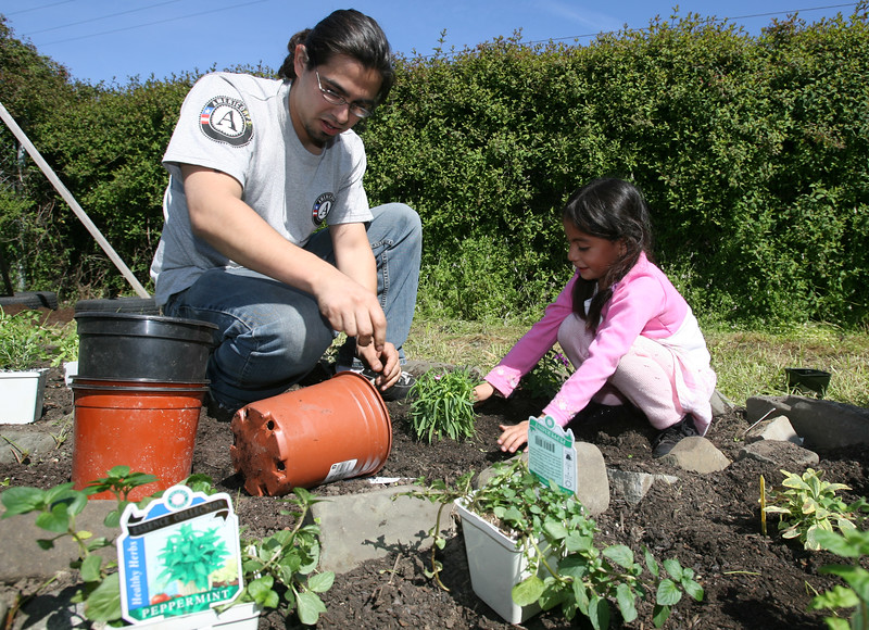 AMERICORPS VOLUNTEERS TEACH KIDS IN HALF MOON BAY