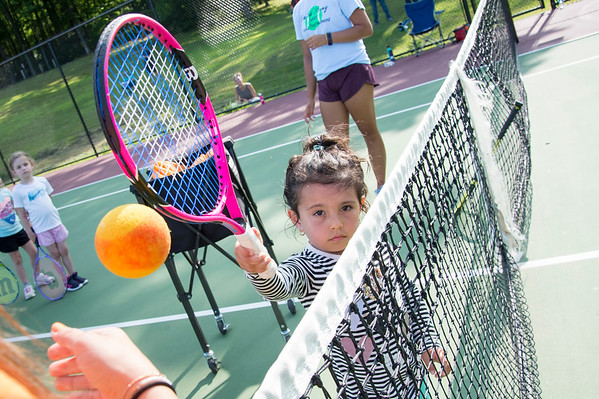 07/08/19 Wesley Bunnell | Staff The Bristol Parks & Recreation department is holding tennis lessons for children ages 4-7 every Monday and Wednesday afternoon through the first week of August at Page Park. Phoenix Arias-Parker , age 4, works on a drill with the help of instructor Stephanie D'Angelo.