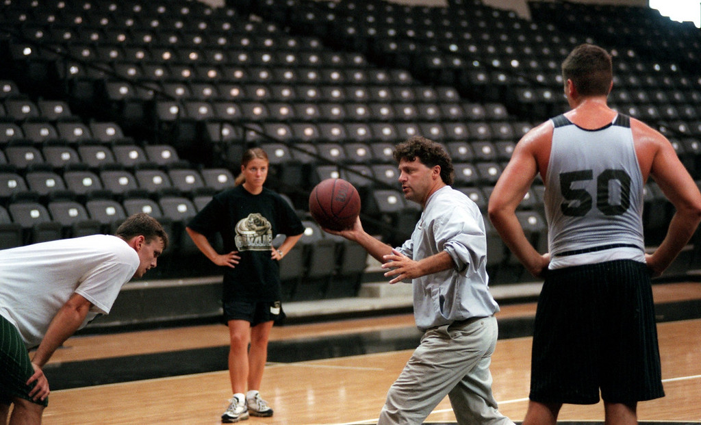 . Jennifer Johntson, the new OU men\'s assistant basketball coach for coach Greg Kampe. She\'s the only female assistant coach in men\'s Division 1 basketball. Here she helps Greg work with Dan Champagne a Jr. from Linden, Mi.,  and Sebastien Bellin from Brussels, Belgium
