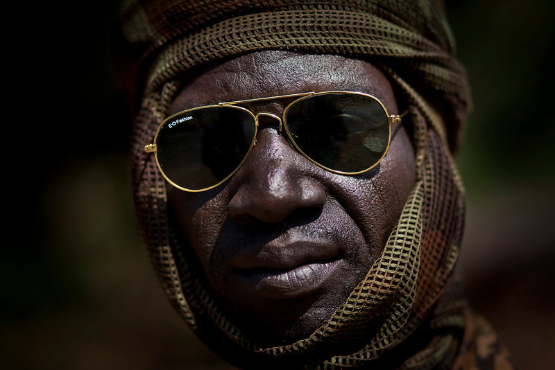 . A Chadian soldier fighting in support of Central African Republic president Francois Bozize, sits on a truck in a convoy of other Chadian soldiers near Damara, about 70km (44 miles) north of the capital Bangui, Central African Republic Wednesday, Jan. 2, 2013. After troops under Bozize seized the capital in 2003 amid volleys of machine-gun and mortar fire, he dissolved the constitution and parliament, and now a decade later it is Bozize himself who could be ousted from power with rebels having seized more than half the country and made their way to the doorstep of the capital in less than a month. (AP Photo/Ben Curtis)