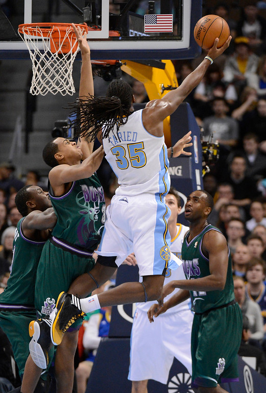 . DENVER, CO. - FEBRUARY 05: Kenneth Faried (35) of the Denver Nuggets goes up for a shot on John Henson (31) of the Milwaukee Bucks during the third quarter February 05, 2013 at Pepsi Center. The Denver Nuggets take on the Milwaukee Bucks in NBA action. (Photo By John Leyba/The Denver Post)