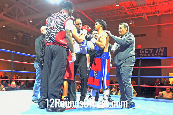 Bout 4  =  CoMain Event:  Thomas Mattice, Red Red and leopard trunks, Cleveland -vs- Guillermo Sanchez, Red and blue  trunks, Buffalo, NY,  Ltweights