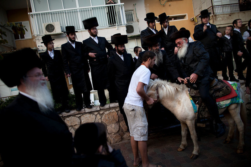 . Ultra-Orthodox Jews gather for a traditional Jewish wedding of the great-grandson of the Rabbi of the Sanz Hasidic followers, in Netanya, Israel, Wednesday, Jan. 2, 2013. Thousands of people that attended the wedding. (AP Photo/Oded Balilty)
