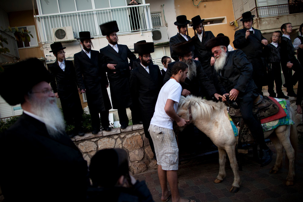 Description of . Ultra-Orthodox Jews gather for a traditional Jewish wedding of the great-grandson of the Rabbi of the Sanz Hasidic followers, in Netanya, Israel, Wednesday, Jan. 2, 2013. Thousands of people that attended the wedding. (AP Photo/Oded Balilty)