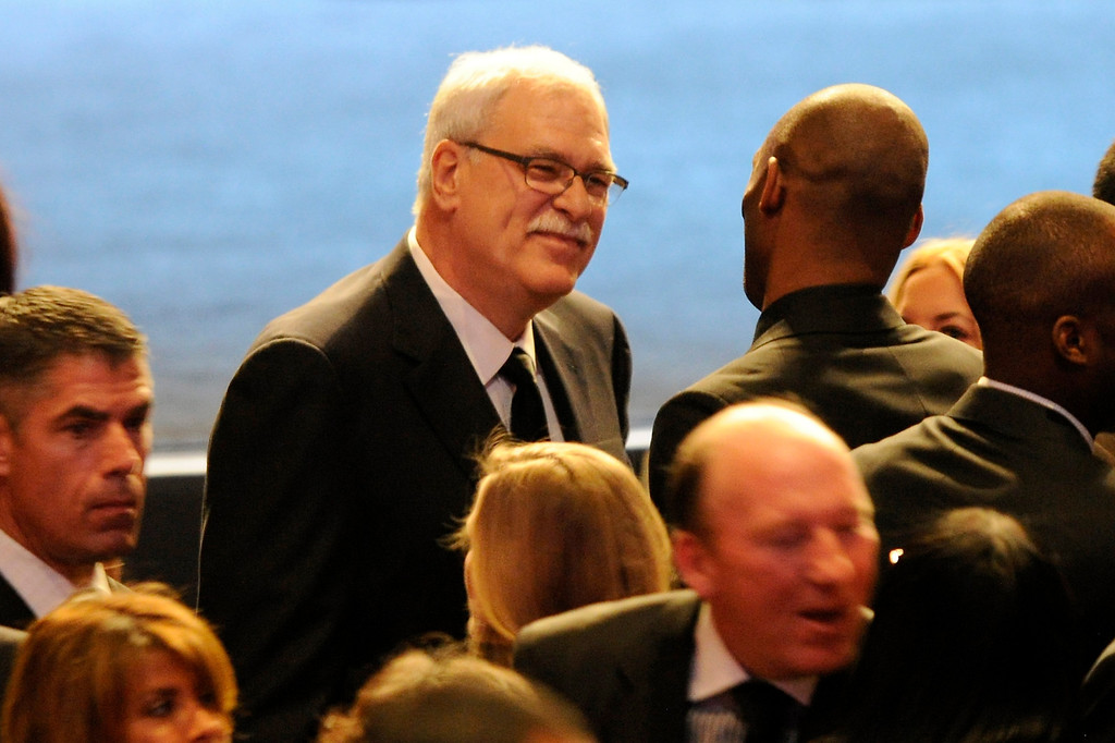 . Phil Jackson and Kobe Bryant talk before the Jerry Buss Memorial Service at Nokia Theatre, Thursday, February 21, 2013. (Michael Owen Baker/Staff Photographer)