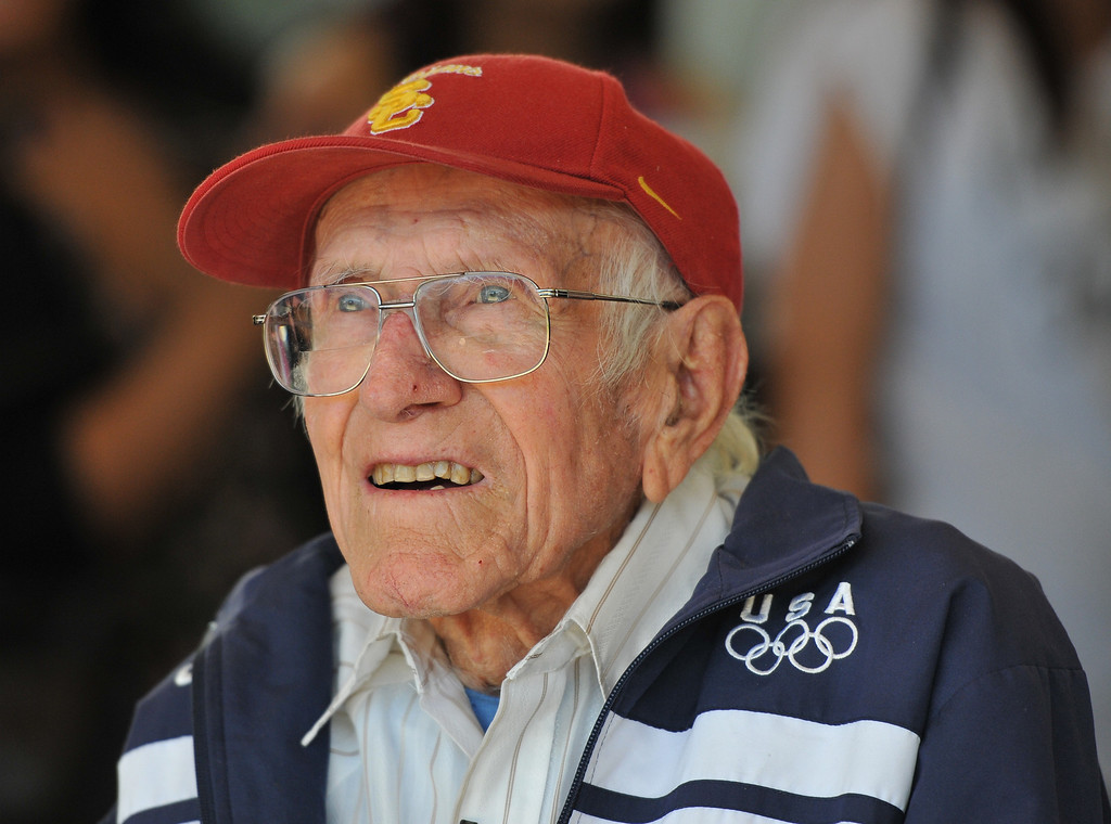 . Torrance---3/31/11---Daily Breeze Photo:  Robert Casillas ---  Torrance legend Louis Zamperini paid a visit to his alma mater Torrance High to visit with alumni and meet students. Zamperini watches cheer leaders perform.