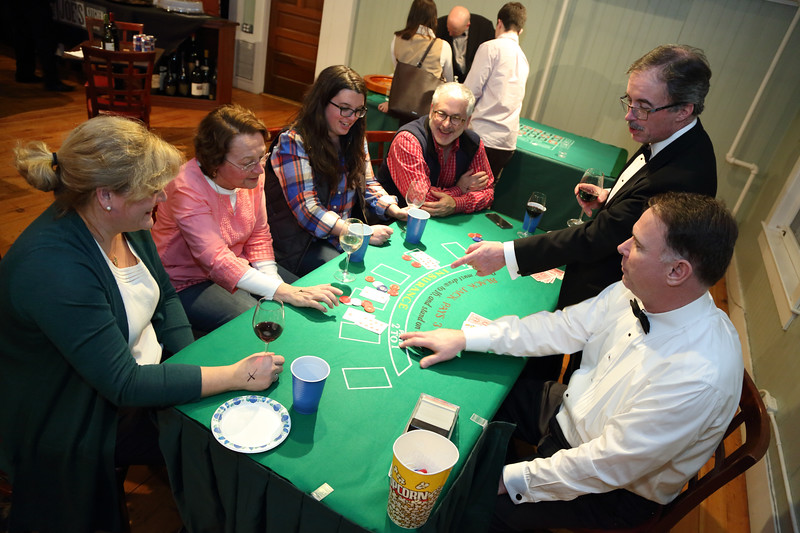 Residents enjoy a game of black jack at a fundraiser for Celebration, the substance-free post-prom party held every year at Bromfield. Clockwise from left: Tina Bardenheuer, Debbie Kaegebein, Collyn Bradley, Craig Bardenheuer, Dennis Bradley, and Bill McHugh.
