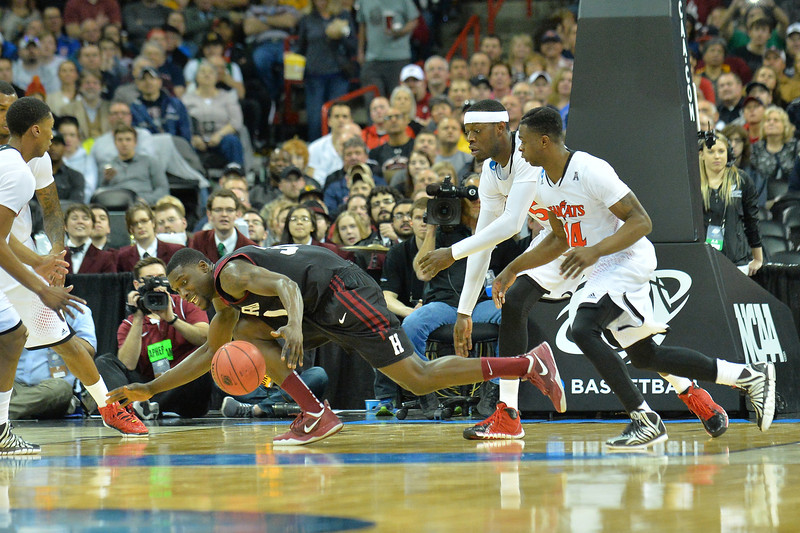 March 20, 2014: Harvard Crimson forward Kyle Casey (30) tries to control a loose ball during a second round game of the NCAA Division I Men's Basketball Championship between the 5-seed Cincinnati Bearcats and the 12-seed Harvard Crimson at Spokane Arena in Spokane, Wash. Harvard defeated Cincinnati 61-57.