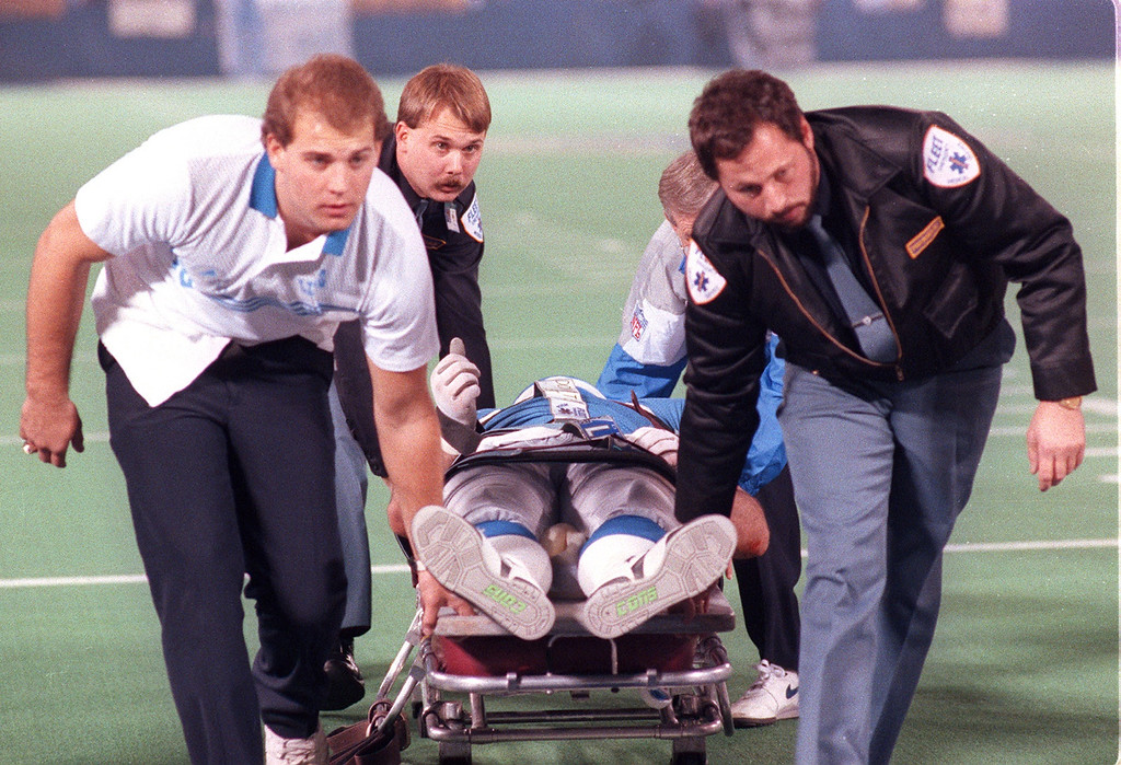 . Detroit Lions and Fleet medical personal wheel Detroit Lions Mike Utly off the field during a game against the Los Angeles Rams on Nov 17, 1991. Utly\'s thumbs up gesture became a rallying cry for the Lions that year  as Utly\'s injury paralized him from the waist down ending his professional football career.