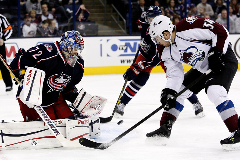 . Columbus Blue Jackets goalie Sergi Bobrovsky, left, of Russia, stops a shot in front of Colorado Avalanche\'s David Jones in the first period of an NHL hockey game in Columbus, Ohio, Sunday, March 3, 2013. (AP Photo/Paul Vernon)