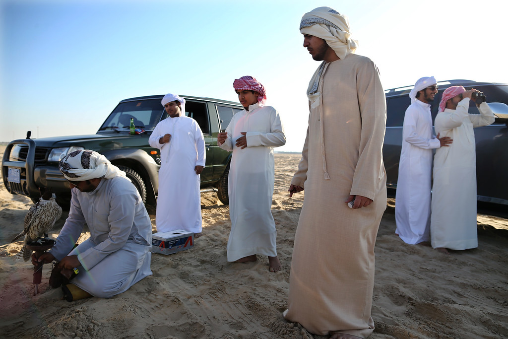 . Emirati men gather to train their falcons on February 3, 2015 in Abu Dhabi, United Arab Emirates.  (Photo by Dan Kitwood/Getty Images)