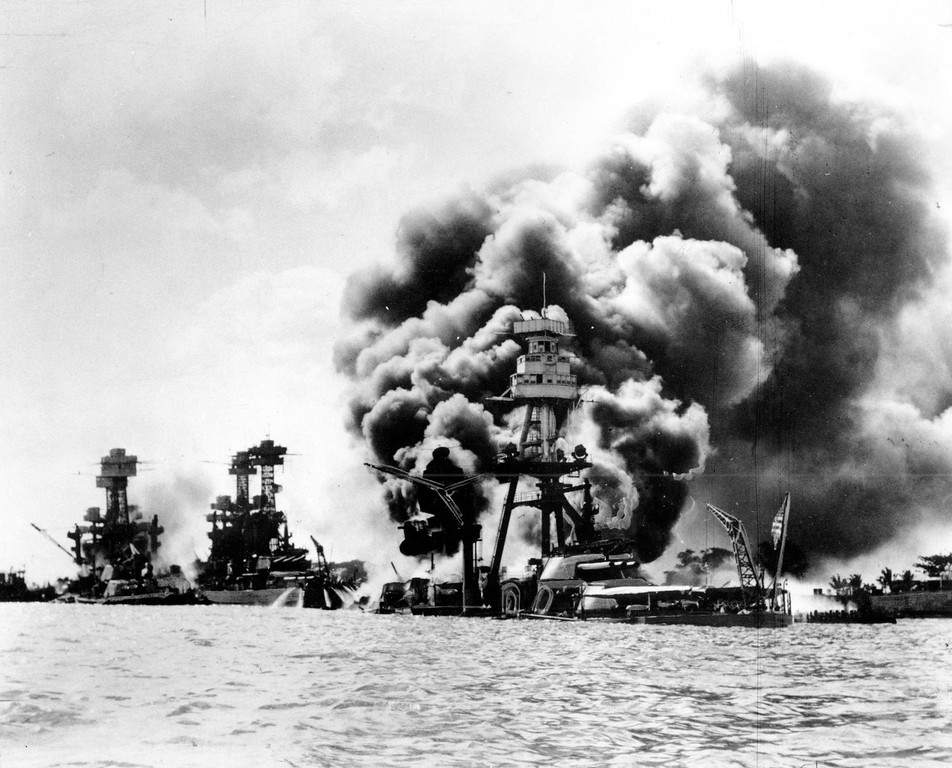 . Three U.S. battleships are hit from the air during the Japanese attack on Pearl Harbor on Dec. 7, 1941.  Japan\'s bombing of U.S. military bases at Pearl Harbor brings the U.S. into World War II. From left are: USS West Virginia, severely damaged; USS Tennessee, damaged; and USS Arizona, sunk.  (AP Photo)