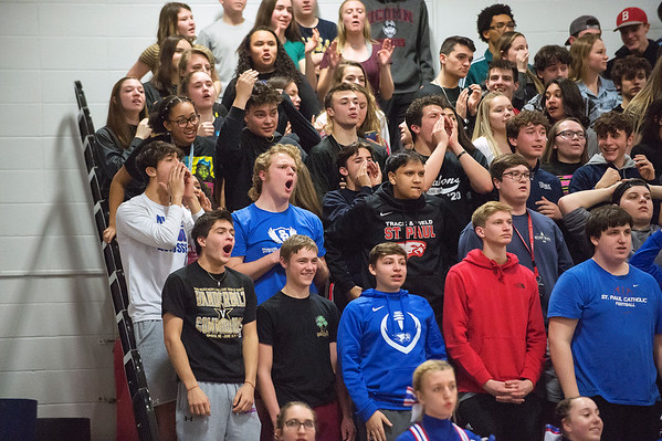 e w03/09/20 Wesley Bunnell | StaffrrSt. Paul boys basketball vs Maloney at St. Paul Catholic High School on Monday March 9, 2020. St Paul students cheer on their team late in the game.