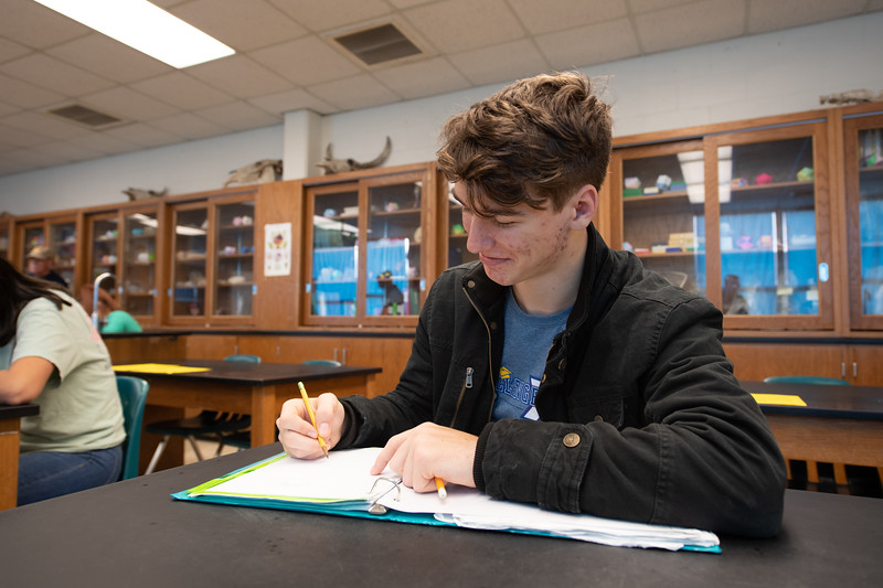 Riviera High School student Jack Mayberry draws a scientist as asked by Dr. Jeffrey Turner.