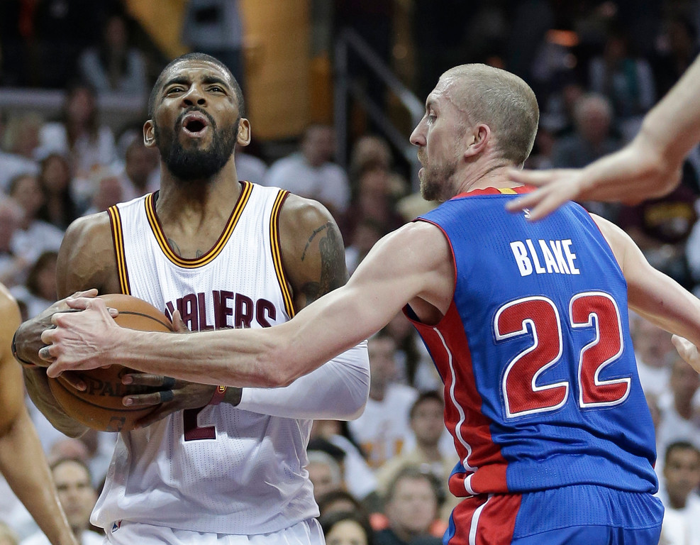 . Cleveland Cavaliers\' Kyrie Irving (2) drives past Detroit Pistons\' Steve Blake (22) in the first half in Game 1 of a