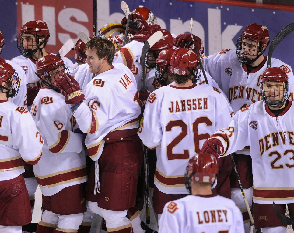 . DENVER, CO. - NOVEMBER 16: The Pioneers celebrated the win Saturday night. The University of Denver hockey team defeated Western Michigan 1-0 at Magness Arena Saturday night, November 16, 2013.  Photo By Karl Gehring/The Denver Post