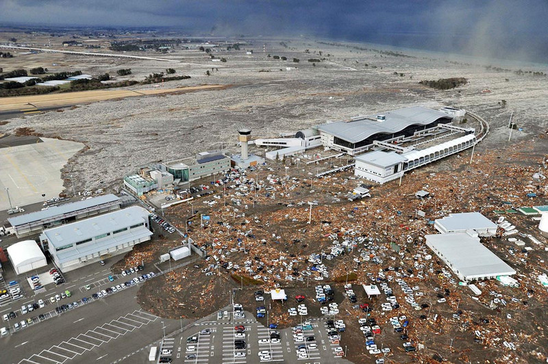 . Tarmac, parking lot and surrounding area are covered with mud and debris carried by tsunami at Sendai Airport in Sendai, Miyagi Prefecture (state) after Japan was struck by a strong earthquake off its northeastern coast Friday, March 11, 2011. (AP Photo/Kyodo News) J