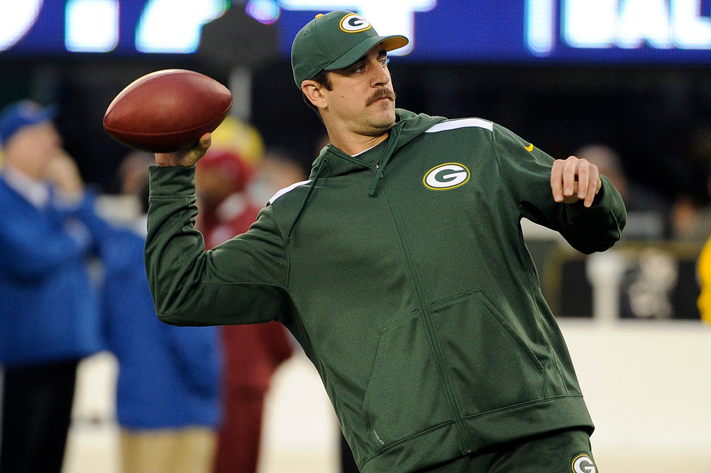 . Green Bay Packers quarterback Aaron Rodgers throws a pass as his team warms up before an NFL football game against the New York Giants, Sunday, Nov. 17, 2013, in East Rutherford, N.J.  (AP Photo/Bill Kostroun)