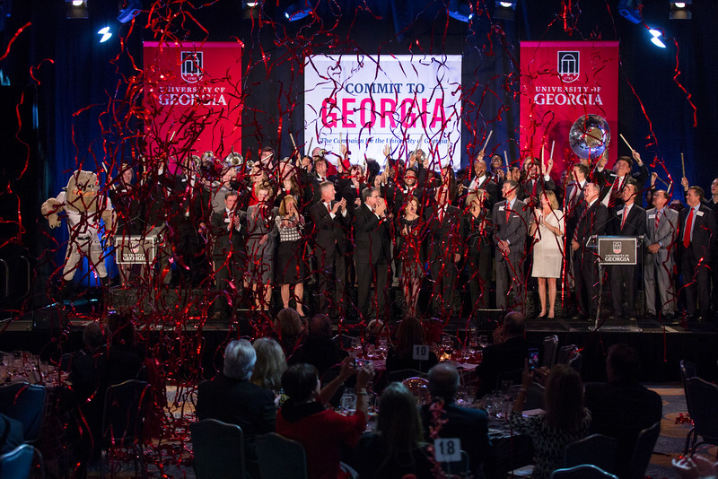 Description: UGA President Jere W. Morehead, surrounded by students and supporters, announces UGAÕs $1.2 billion goal for the Commit to Georgia campaign, the largest in the universityÕs history during the Capital Campaign Kickoff Event in Atlanta at the Georgia Aquarium.Date of Photo: 11/17/2016Credit: Andrew Davis Tucker, University of GeorgiaPhotographic Services File: 34431-173The University of Georgia owns the rights to this image or has permission to redistribute this image. Permission to use this image is granted for internal UGA publications and promotions and for a one-time use for news purposes. Separate permission and payment of a fee is required to use any image for any other purpose, including but not limited to, commercial, advertising or illustrative purposes. Unauthorized use of any of these copyrighted photographs is unlawful and may subject the user to civil and criminal penalties. Possession of this image signifies agreement to all the terms described above.